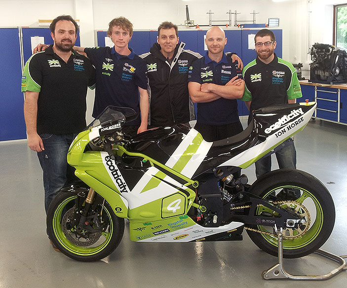 Principal lecturer Paul Brandon, centre, with the student team who helped build the Phoenix electric motorbike.