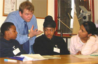 Photo of Head of History at Lampton School Reuben Moore with 3 students