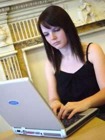 Photo of student using a laptop computer.