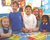 Photo of Diana Kill with pupils at Coombe Hill Infant School.