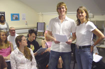 Photo of creative writing student Jonathan Willock, centre, and Dr Meg Jensen.