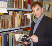Photo of Dr Vassilis Fouskas in the Vane Ivanovic Library.