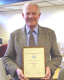 Photo of Tom Geake with award.