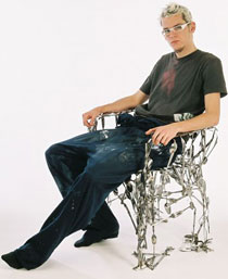 Photo of Osian Batyka-Williams with his cutlery chair.