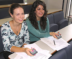 Final year business students Charis Fairhead, left, and Joanna Miltiadou use their remote controls.