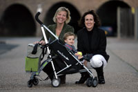 A practical holdall attachment designed by Charlotte Evans, left, and Carolyn Jarvis could soon be a must-have item for parents tired of contending with pushchairs and bulky shopping bags.