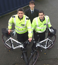 Sergeant Matt Smith (left) and PC Matt Cefai (right) with Kingston University Head of Student Affairs Glyn Jones (centre).