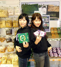 Korean students Kim Sujeong (left) and Chae Sooeun with Fairtrade goods in Kingston University's Students' Union shop.