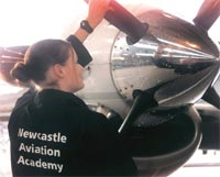 Photo of a student from the Newcastle Aviation Academic working on an aircraft