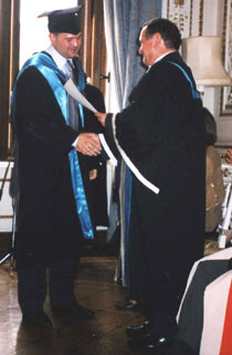 Photo of Andrey Zorin, left, receiving his MBA from Pro Vice-Chancellor for External Affairs and Business Development Professor David Miles.
