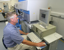 Photo of Dr Ian Jarvis testing the new ICP-AES.