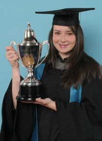 Photo of Susan Ruggles with the Andrew Yale Cup.