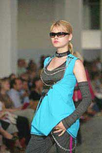 Photograph of models wearing designs by Kingston University fashion students
