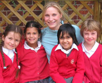 Photo of Anna-Lena Kleinert with pupils from the Mount Primary School.
