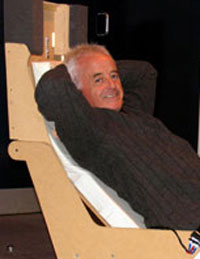 Inventor Dominic Robinson demonstrates his aircraft seat