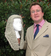 Senior lecturer John Tribe shows off a 19th Century ceremonial wig housed in the Muir Hunter Museum of Bankruptcy at Kingston University's School of Law.