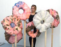 Student Sophie Taylor looks at work by fellow student John Brown entitled 'You will never gain weight from a doughnut hole'