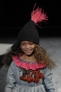 A model wears an outfit designed by childrenswear designer Laura Harvey.